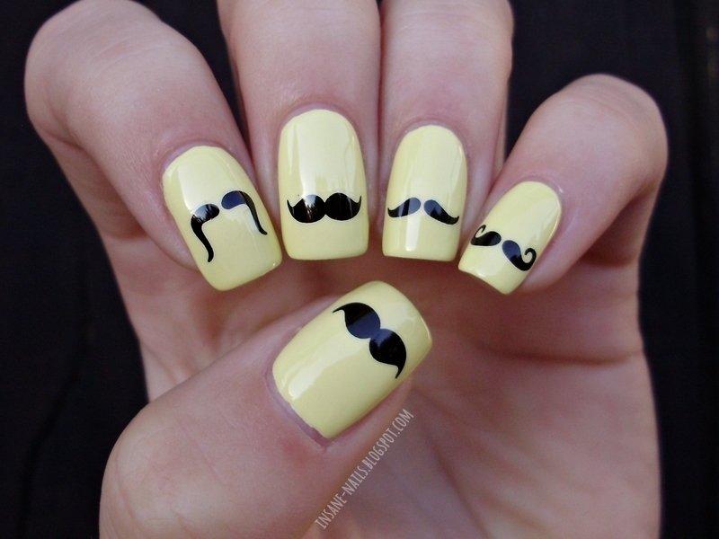 unhas em amarelo com bigodinho