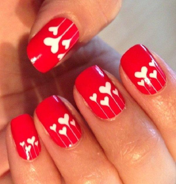 unhas pintadas de vermelho